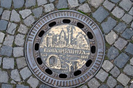 Photo texture of a manhole in one of the streets of Belgrade. Editorial
