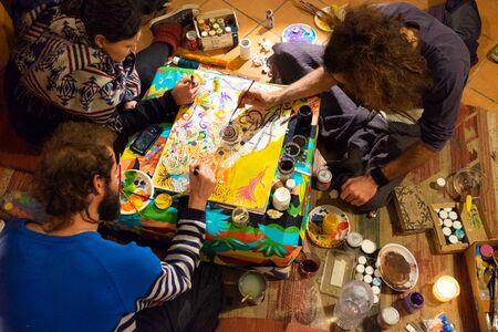 Sicily, Italy - February 08, 2016: Group of artists making a collaborative painting in Catania.