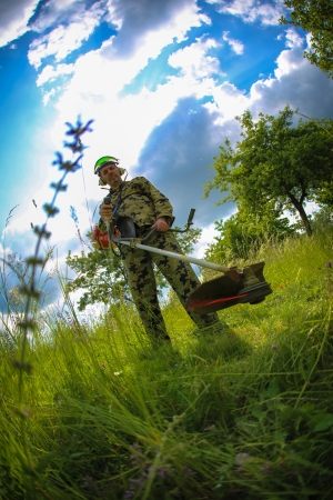 man with lawn trimmer in action