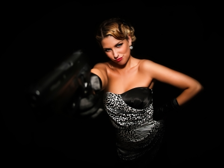 holding a gun on black background photo