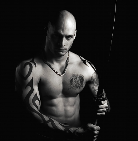 warrior with sword on black background photo