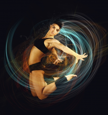 jumping woman on black background 写真素材
