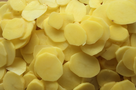 Sliced potatoes prepared for cooking, ingredients for cuisine