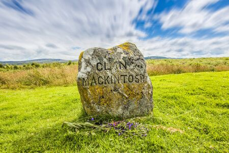 Clouds roll over a medieval gravestone for clan Mackintosh from the battle of Bannockburn.