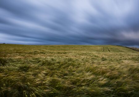 Long exposure of a Scottish squall  raking across the coastal fields of Old Hall Bay of eastern Scotland. Reklamní fotografie