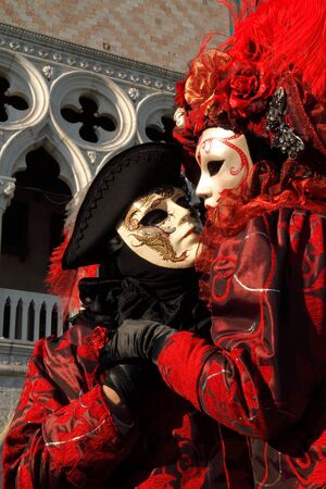 Masked Lovers in Red at Venice Carnival  photo