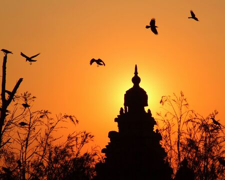 mamallapuram: Shore Temple Mamallapuram with Birds at Sunset Stock Photo