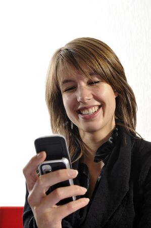 phoning: laughing young woman by phoning