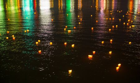 blue candles: Colourful reflections on the water at night
