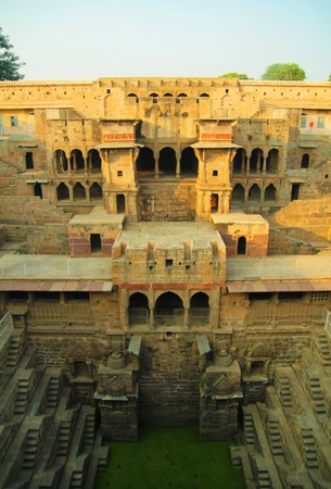 chand baori: Giant stepwell with doors and windows in sunlight Stock Photo