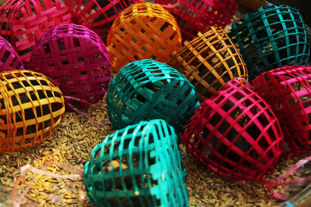 trapped: small birds trapped in colourful bamboo cages