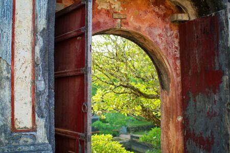 view through door: View through open door of old, asian gate in park