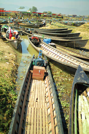 too many: Too many wooden boats in a dry river Stock Photo