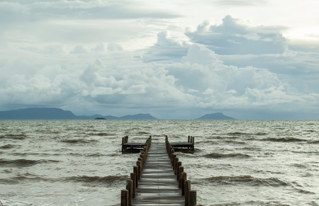 empty jetty and cloudy sky