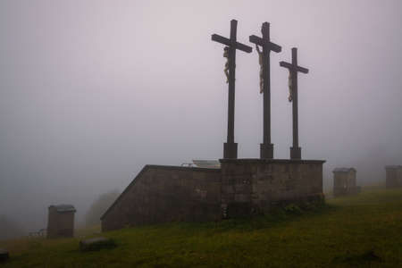 Three crosses on Kreuzberg mountain in Rhoen, rainy summer day