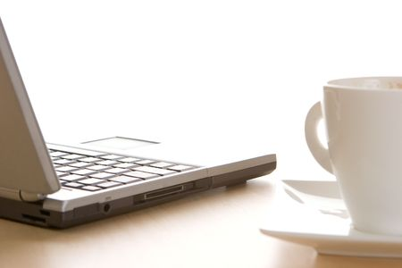 A laptop and a cup of coffee Stock Photo - 783757