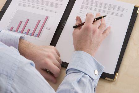 A business man reading through a contract photo