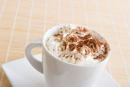 intense flavor: A cup of coffee with  cream and chocolate on top Stock Photo