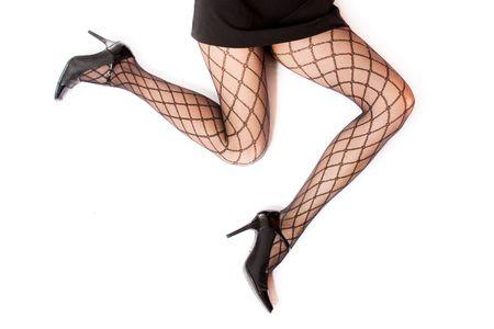 female legs in fishnet stockings Imagens