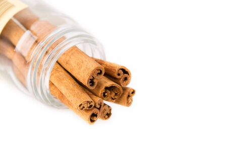 appetize: Cinnamon stick in a glass bottle