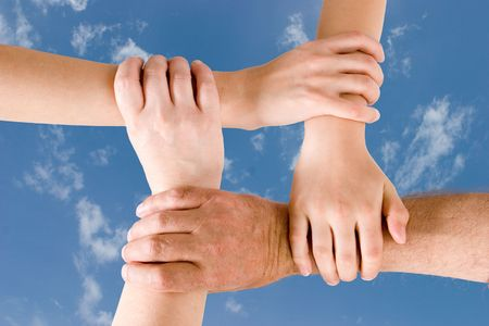 unanimous: Four hands joined together