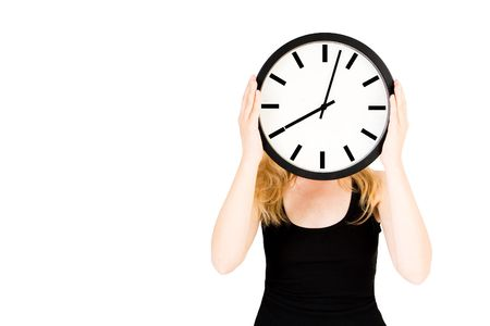 timescale: A blond woman holding a clock infront of her face