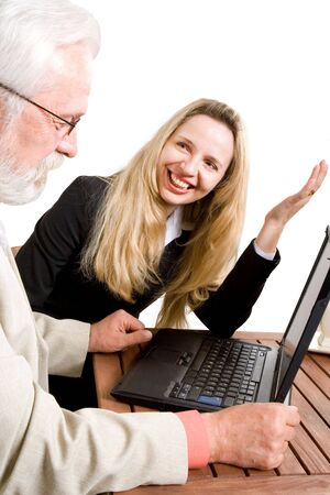 A blond business woman gesturing to her collegue Stock Photo - 2432214