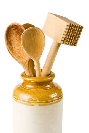 implements: Wooden kitchen implements on a white background