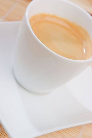 musetti: A cup of espresso on a white saucer