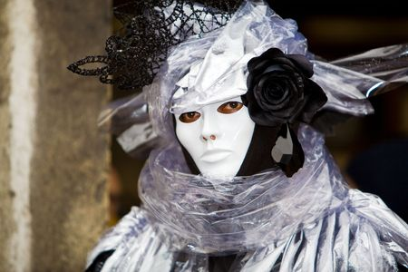 customs and celebrations: A man with a black rose and Venetian costume