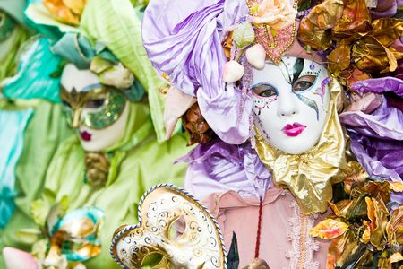 customs and celebrations: Two people in elaborate masks at the Venice Carnival