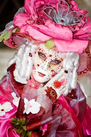 customs and celebrations: A rose mask at the Venice Carnival