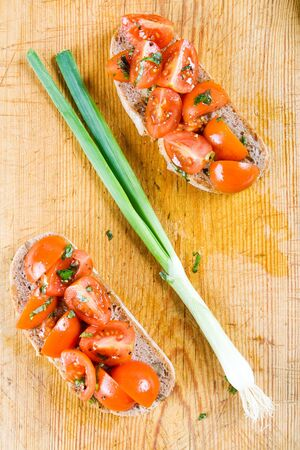 customs and celebrations: Ham and tomato sandwiches with a fresh spring onion Stock Photo