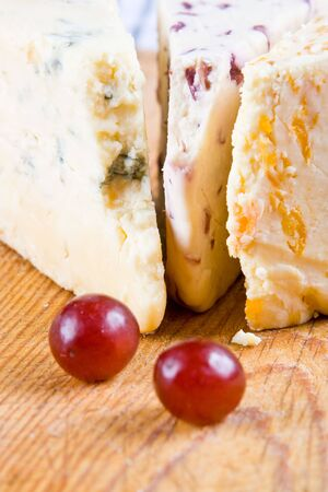 stilton: Cranberry, apricot and blue stilton with two red grapes Stock Photo