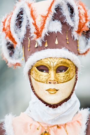 customs and celebrations: Cream and brown costume at the Venice Carnival