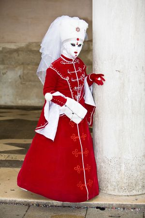 customs and celebrations: Red velvet costume at the Venice Carnival