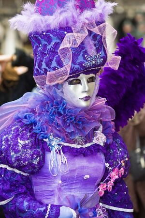customs and celebrations: Two people in costume at the Venice Carnival