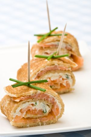 lunch buffet: Fresh salmon and cream cheese canapes with chives Stock Photo