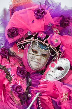customs and celebrations: Pink costume at the Venice Carnival
