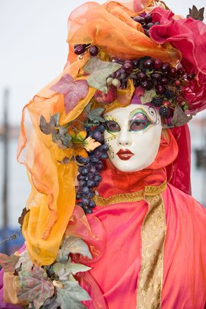 customs and celebrations: Red and orange costume at the Venice Carnival Stock Photo