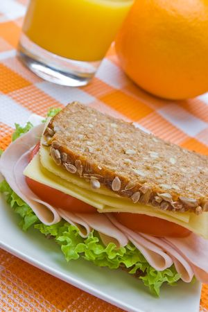 tomato juice: Fresh wholemeal cheese and ham sandwich with orange juice