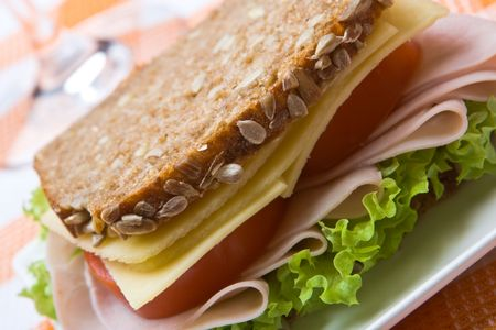 Fresh wholemeal cheese and ham sandwich photo