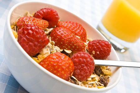 Muesli with fresh raspberries and strawberries photo