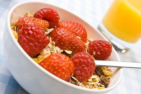 Muesli with fresh raspberries and strawberries photo