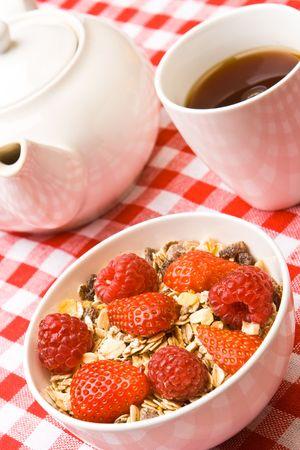 sultanas: Muesli with fresh raspberries and strawberries Stock Photo