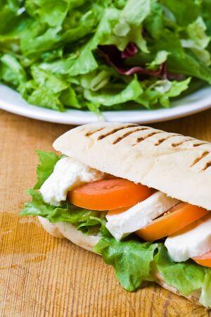 Lettuce, tomato and mozzarella in a fresh panini