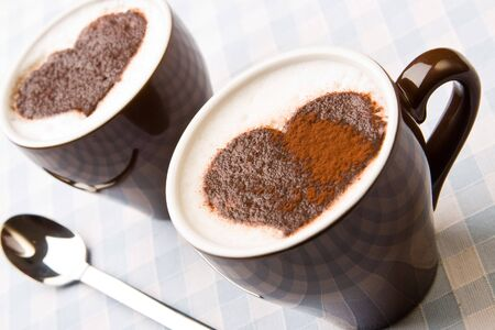 Hot cappuccino with a chocolate heart