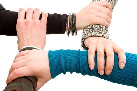 compromiso: Cuatro manos unidas aisladas en blanco