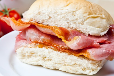 Delicious crispy bacon sandwich on a plate photo