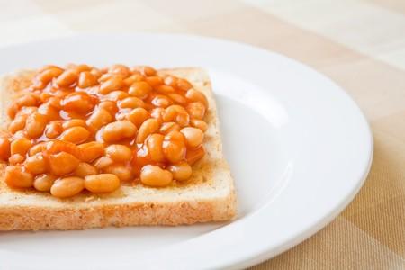 british cuisine: Delicious baked beans on toast on a plate